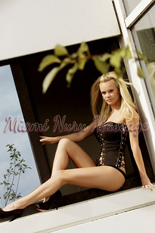 Sexy blonde in lingerie with large bust exposed